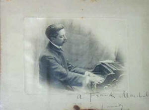 Photo of Granados playing piano, dedied to his pupil Franck Marshall.