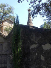 Cemetery of Olius - Stone, alzines, cypress and a cross.